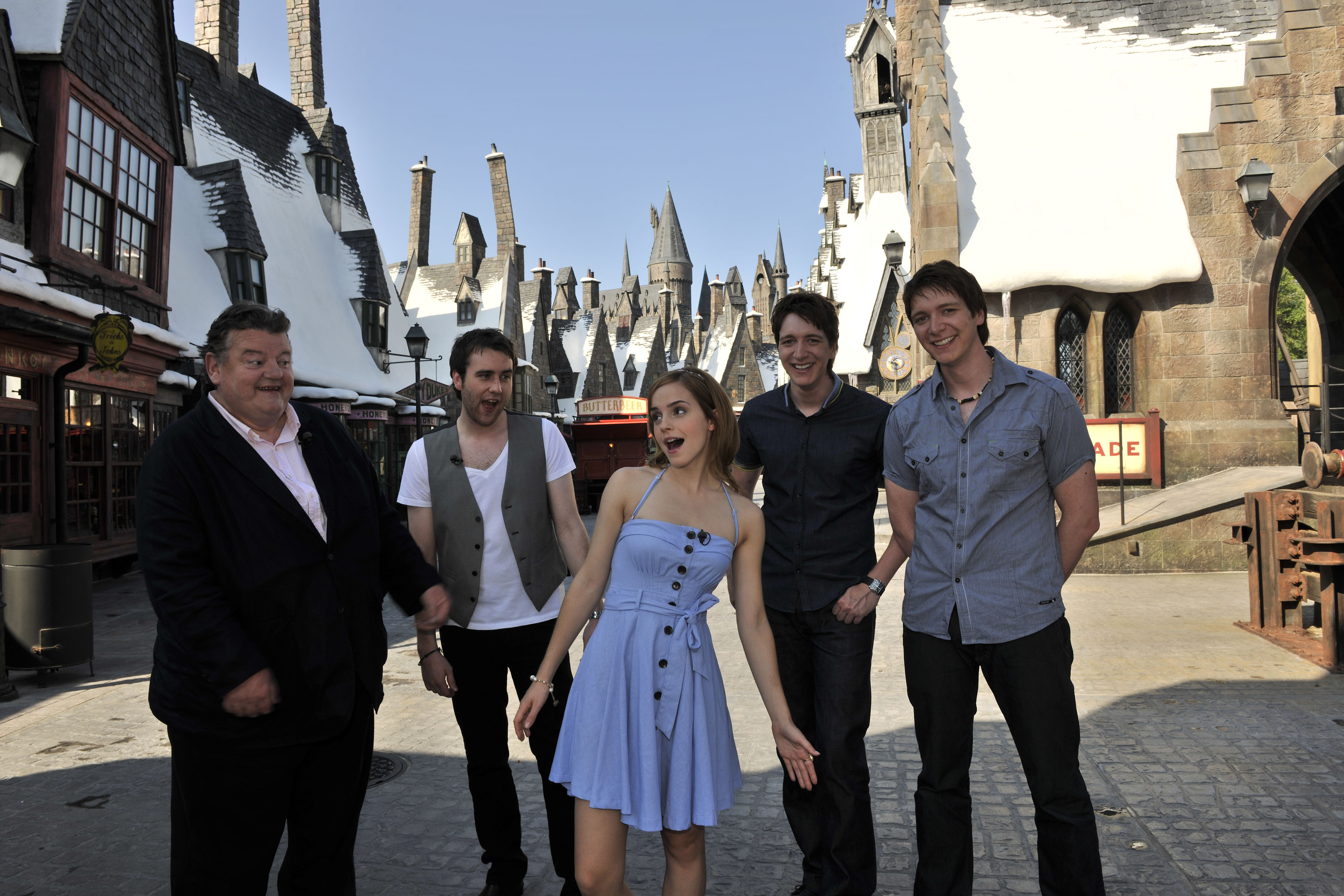 Harry Potter cast infront of the Harry Potter set at Orlando Universal Studios