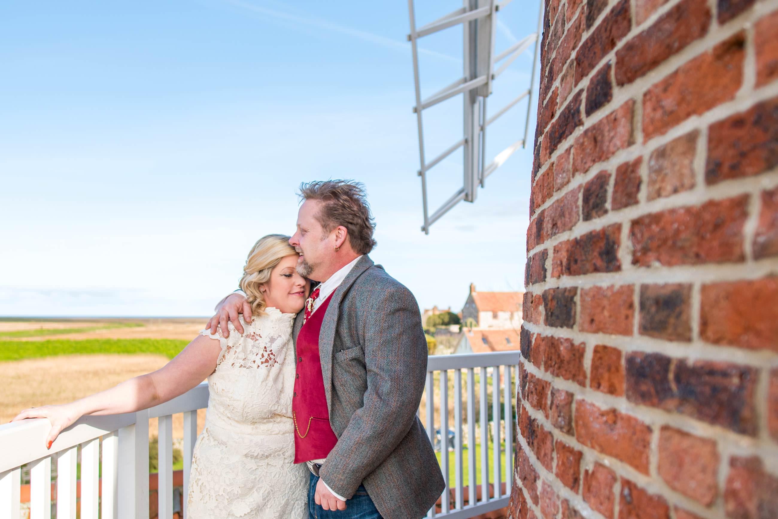 wedding-couple-on-the-windmills-balcony