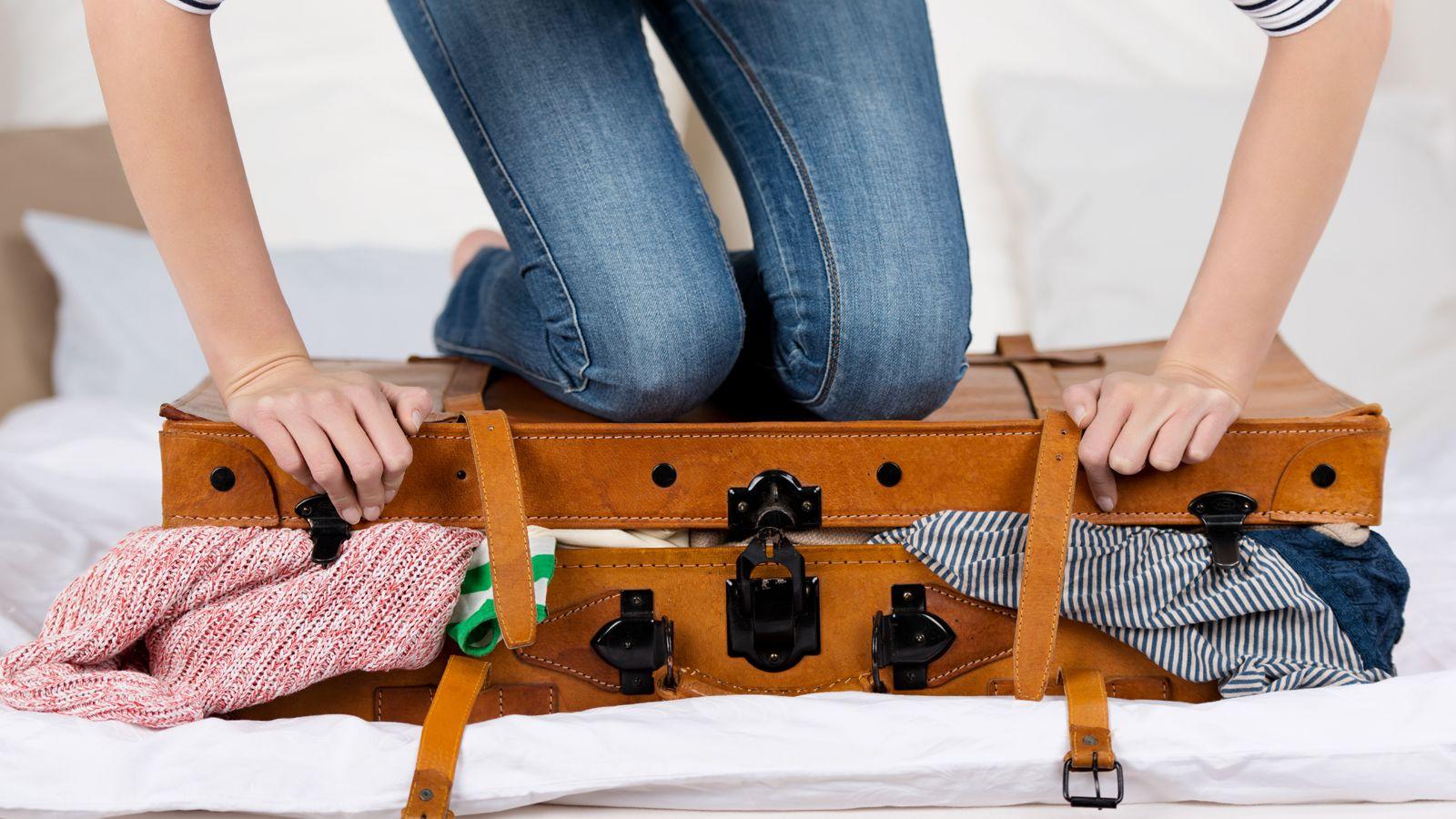 an-overstuffed-suitcase