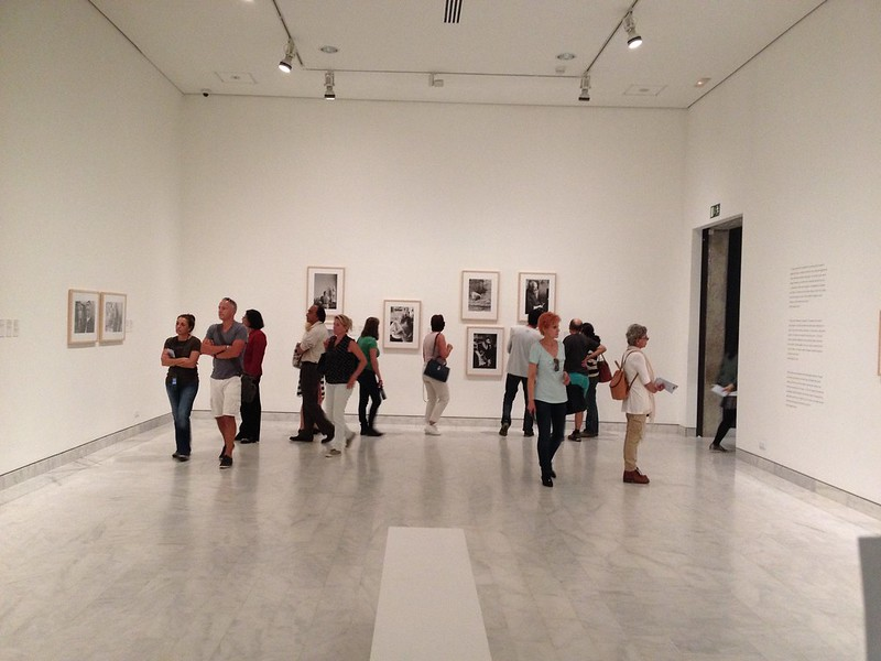 People looking at paintings