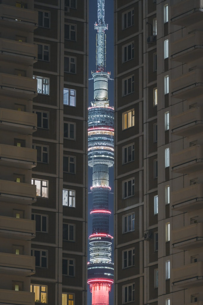 A view of Ostankino tower through the buildings in moscow