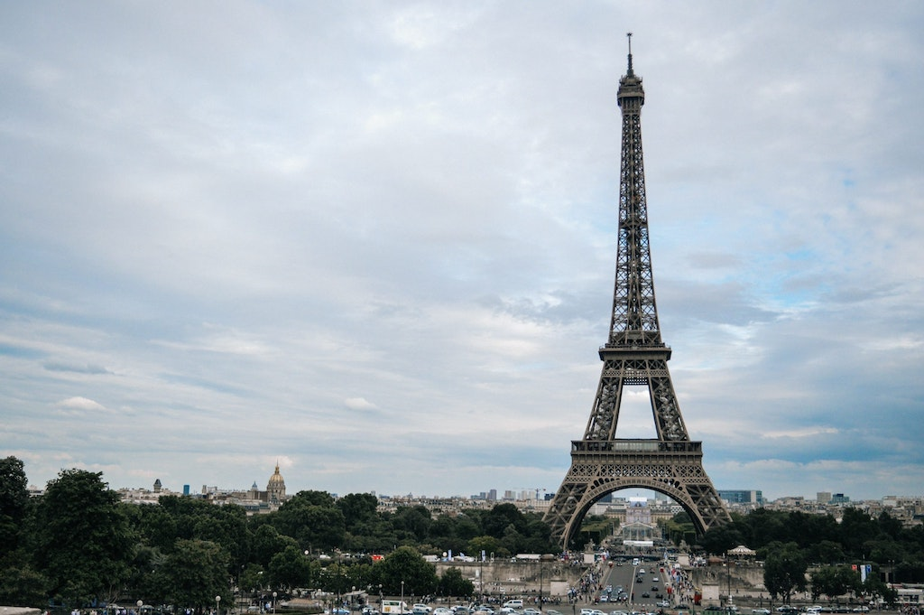 A long shot photograph of Eiffel Tower amid the busy city of Paris