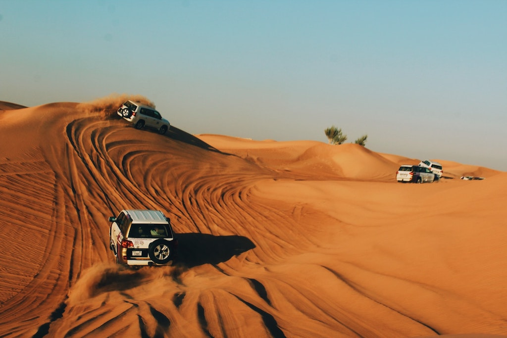 Cars bashing into the sand dunes