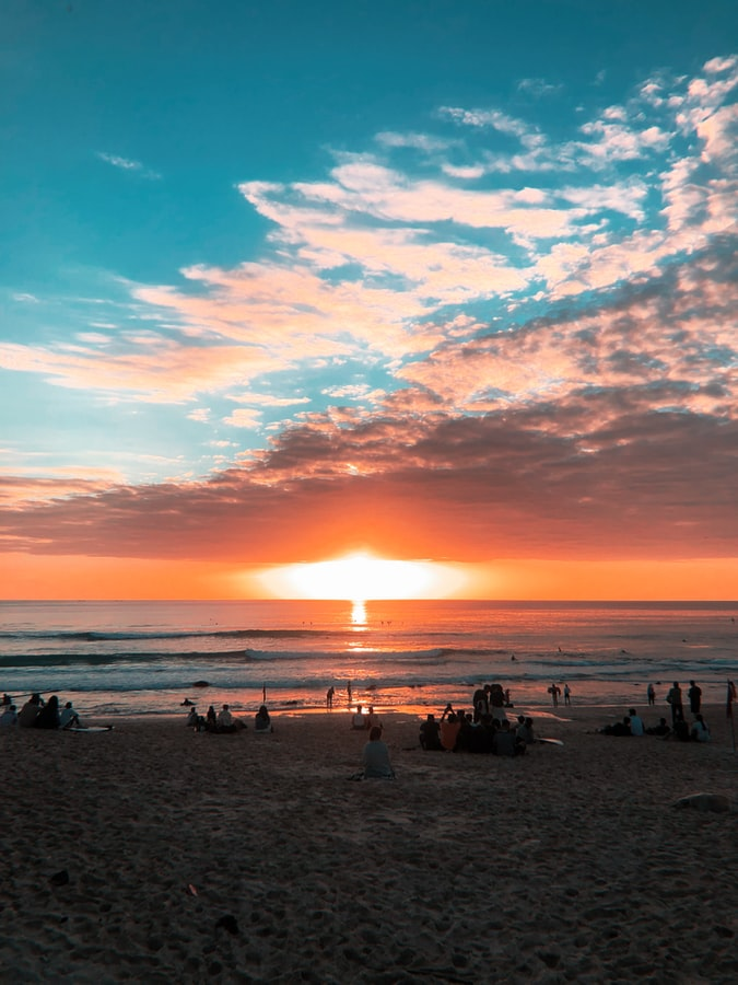 Relax by Kuta Beach and watch a scenic sunset