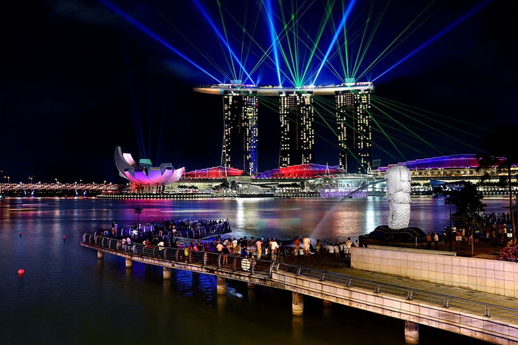 People enjoying the light show at the Marina Bay Sands, which one of the best things to do in SIngapore