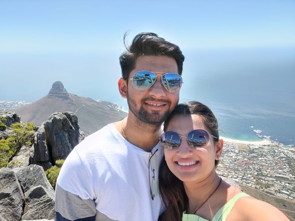 A couple clicking a selfie at a beach in South Africa