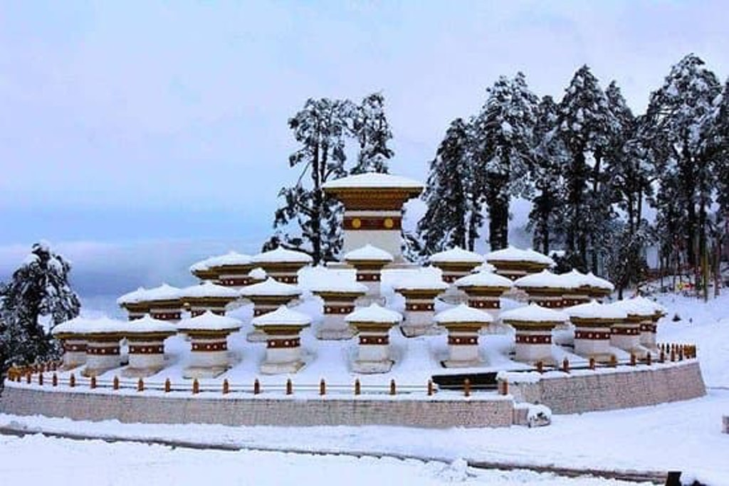 The picture of Dochula pass covered eith snow capped mountains for hiking in Bhutan