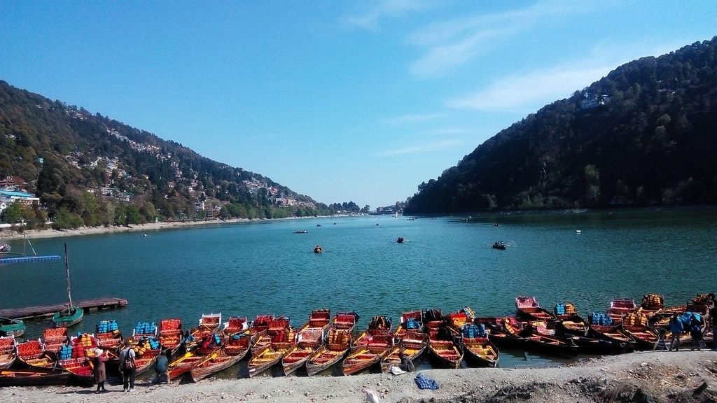 A beautiful view of Naini lake - popular among the Places to Visit in Uttarakhand.