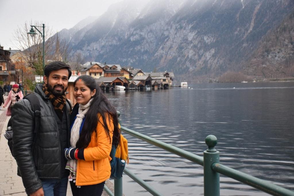 A couple posing in Hallstat. Salzburg on their honeymoon trip