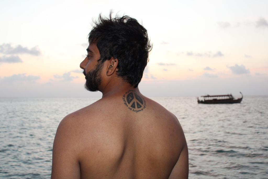A man with a background of Sea in maldives