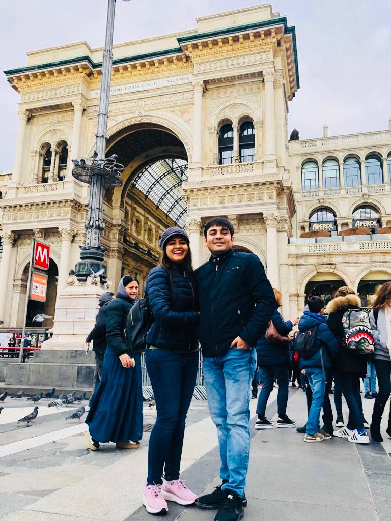 Couple at a famous mall in Galleria Vittorio in their honeymoon trip