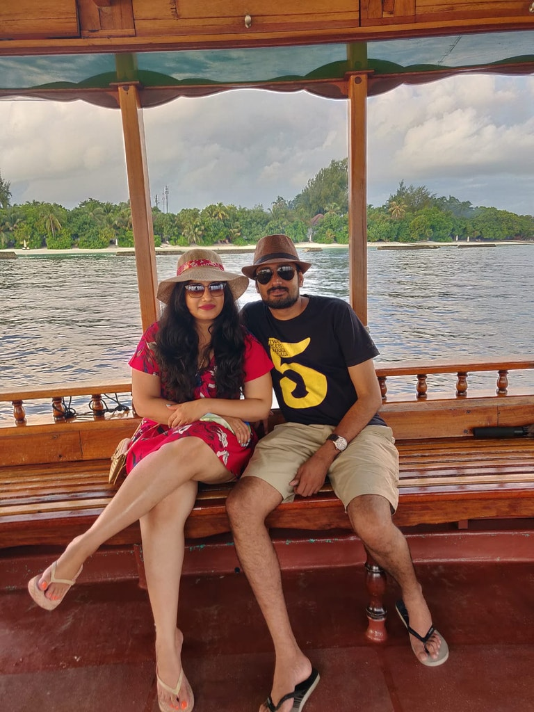 enjoying the boat ride on our trip to Maldives