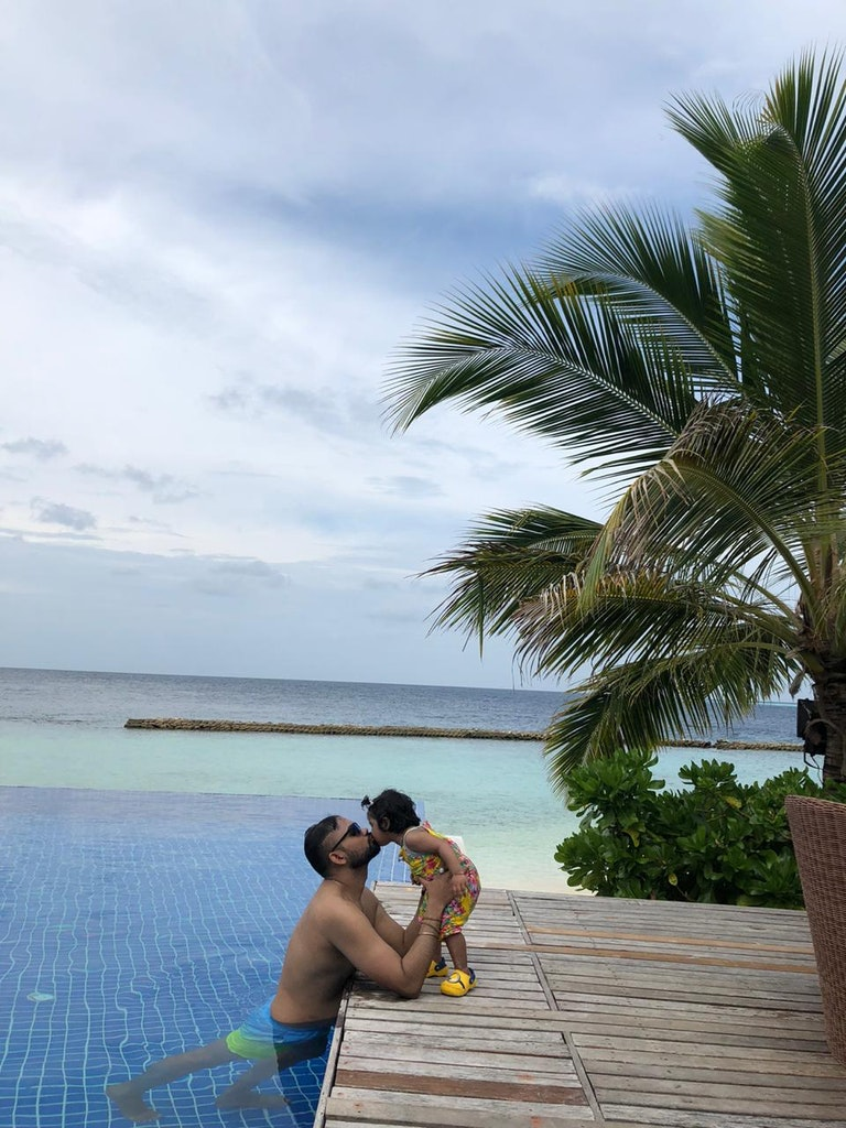 ambrish and his baby at the resort