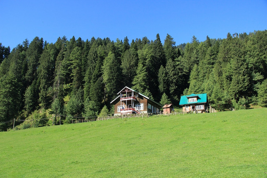 Homes on pristine green land, Pahalgam, one of the top hill stations in India