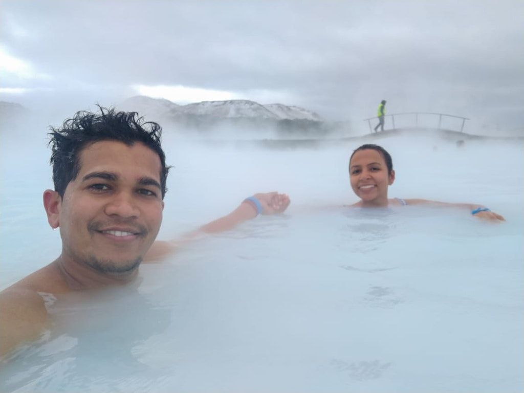 A couple taking a bath in the cold water in Iceland