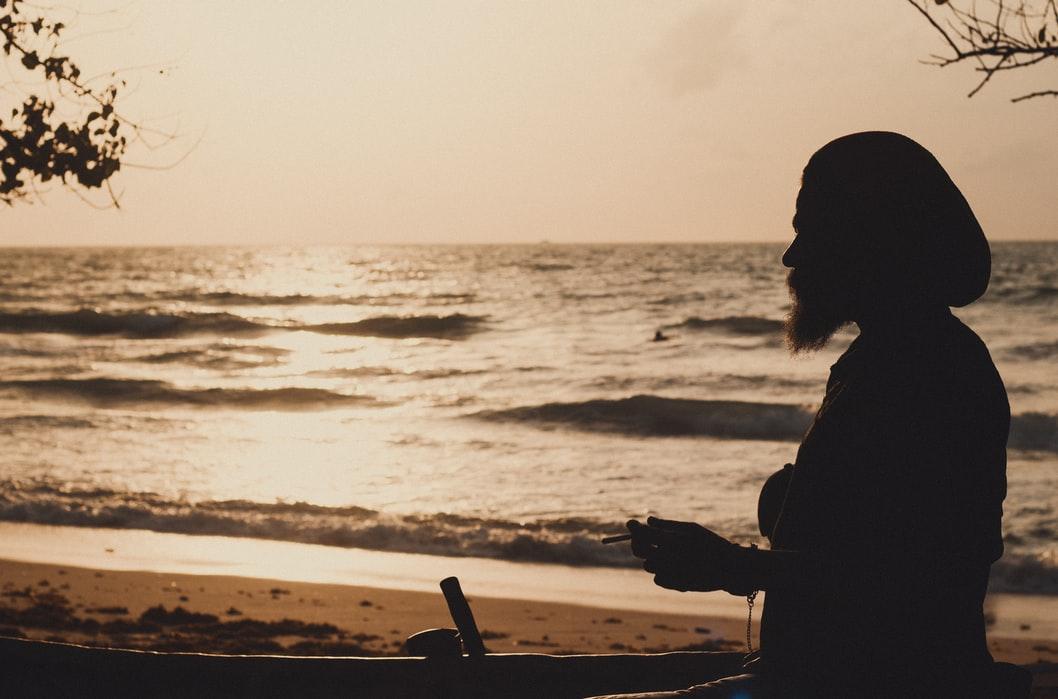 man at beau vallon beach in mahe