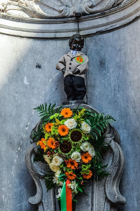 Dressing Manneken Pis in Belgium wearing a suit