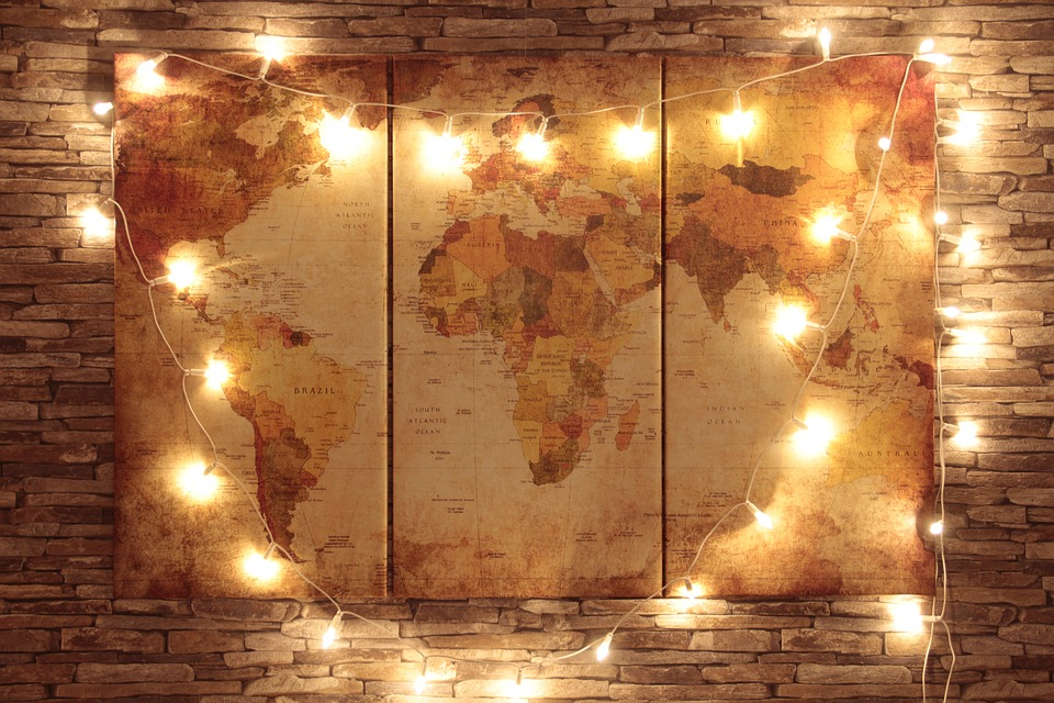 World map lit by fairy lights