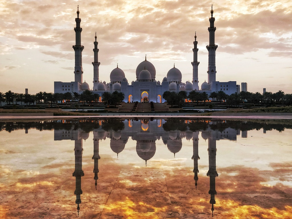 Majestic Reflections of Sheikh Zayed Grand Mosque and fiery golden sky