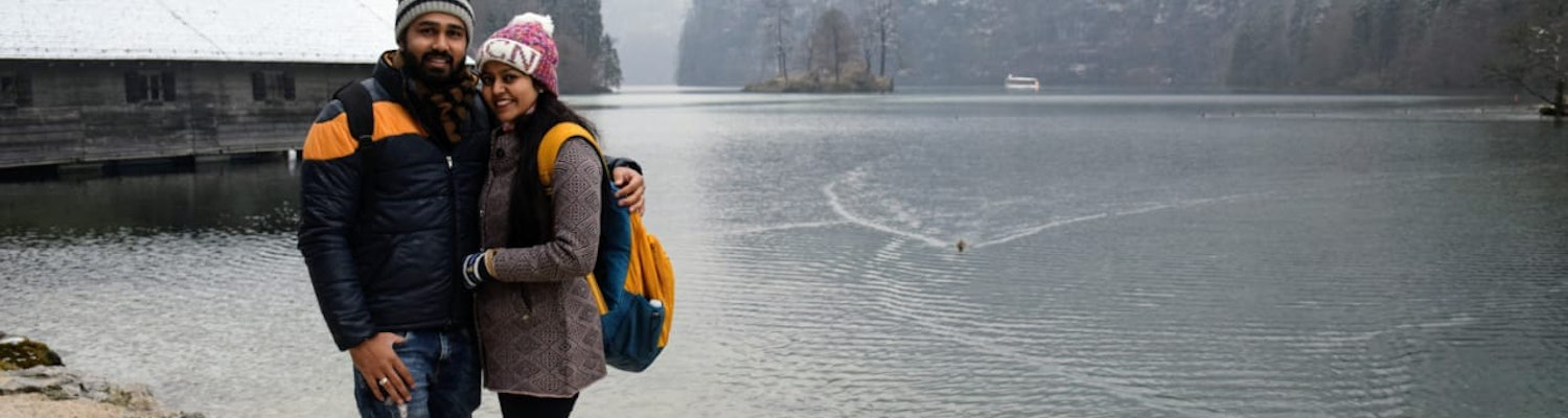 A cute couple posing at King's lake in central Europe