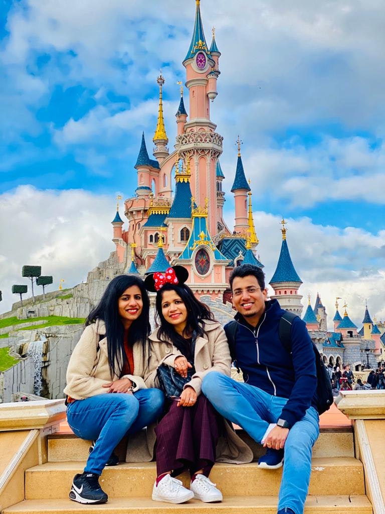 with my family in front of disney land