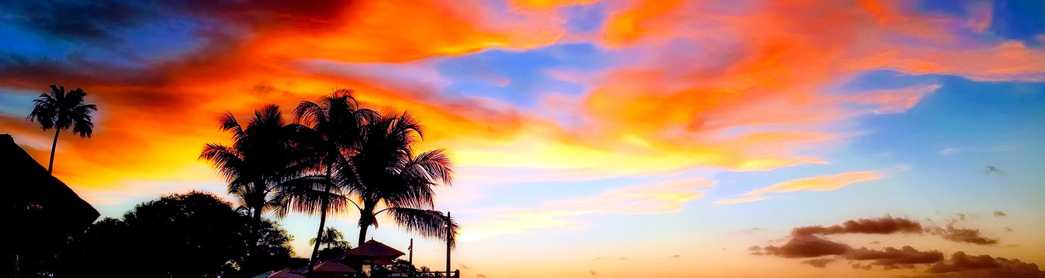 An awe-striking sight of the sunset in Seychelles Island