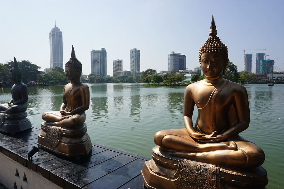 Buddha statues in the walls of Beira Lake in Moratuwa