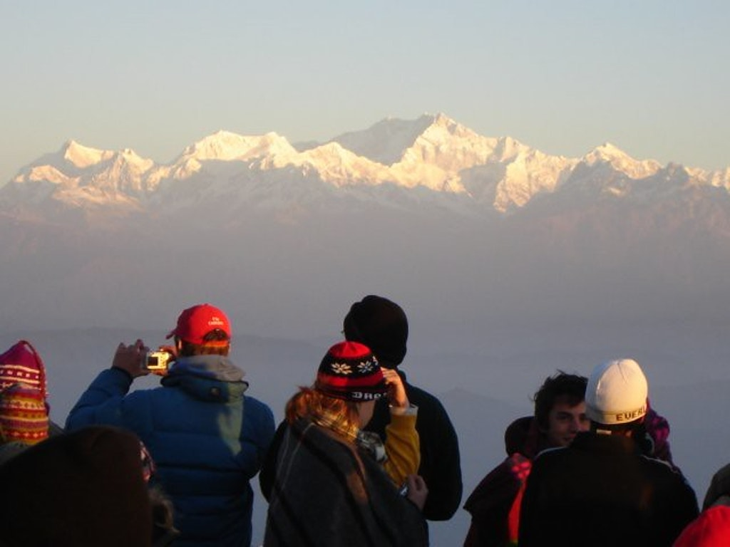 A picture of a group of tourists showing the strength of tourism in Darjeeling