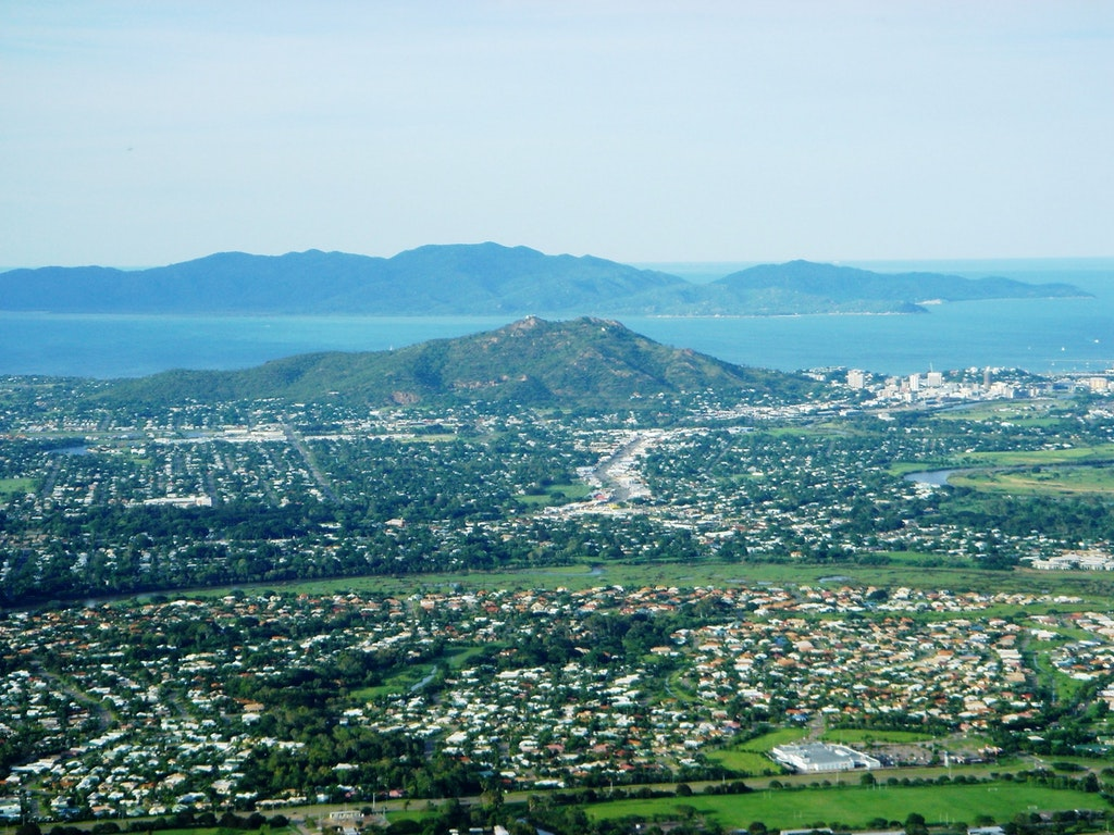 The panoramic view of Townsville with Castle hill on the right centre.