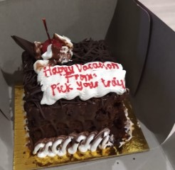 A picture of a cake on their honeymoon vacation to Bali