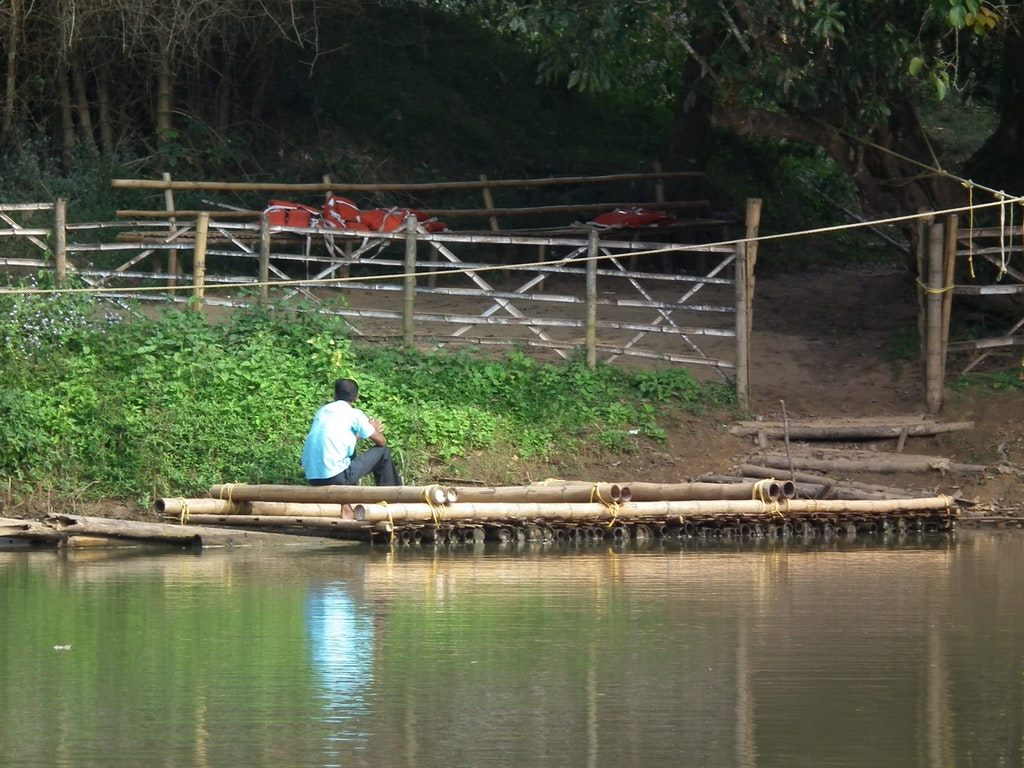 A picture of a man sitting on a boat in Kuruvadweep in Kerala