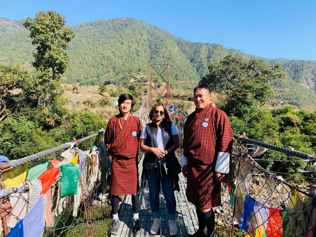 A picture with the localites during my solo trip to Bhutan