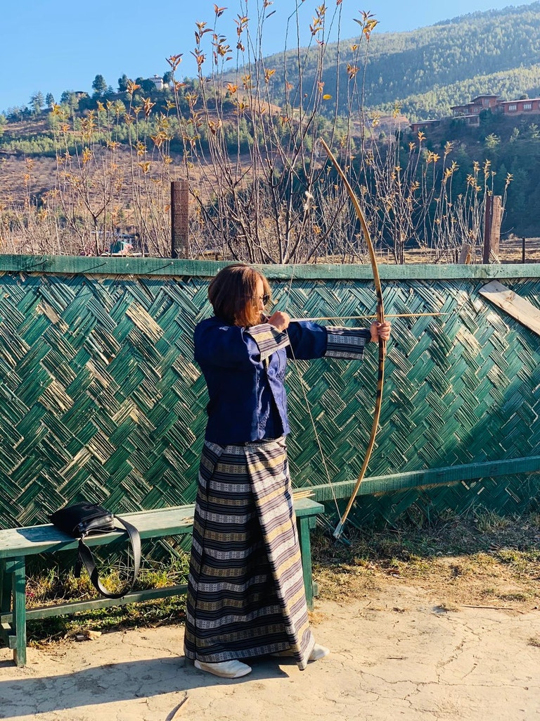 Trying out the national sport, archery during my solo trip to Bhutan