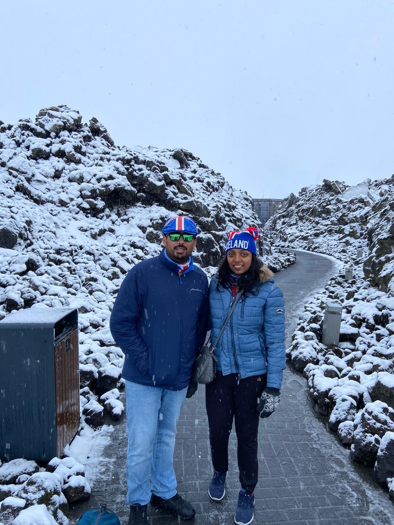 A couple standing on the roads of Iceland in Europe