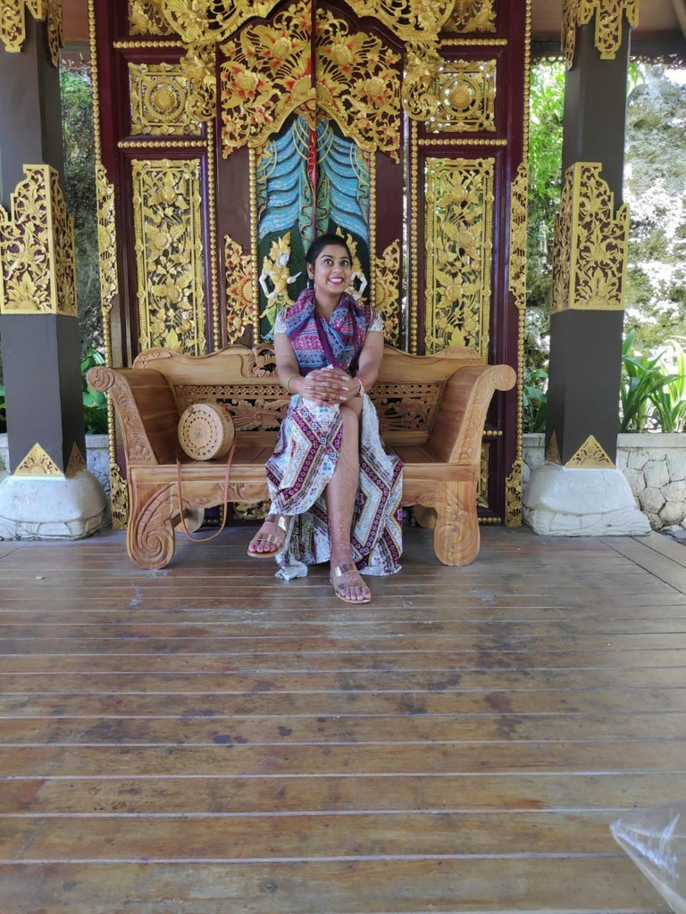 A girl sitting in one of the temples in Bali