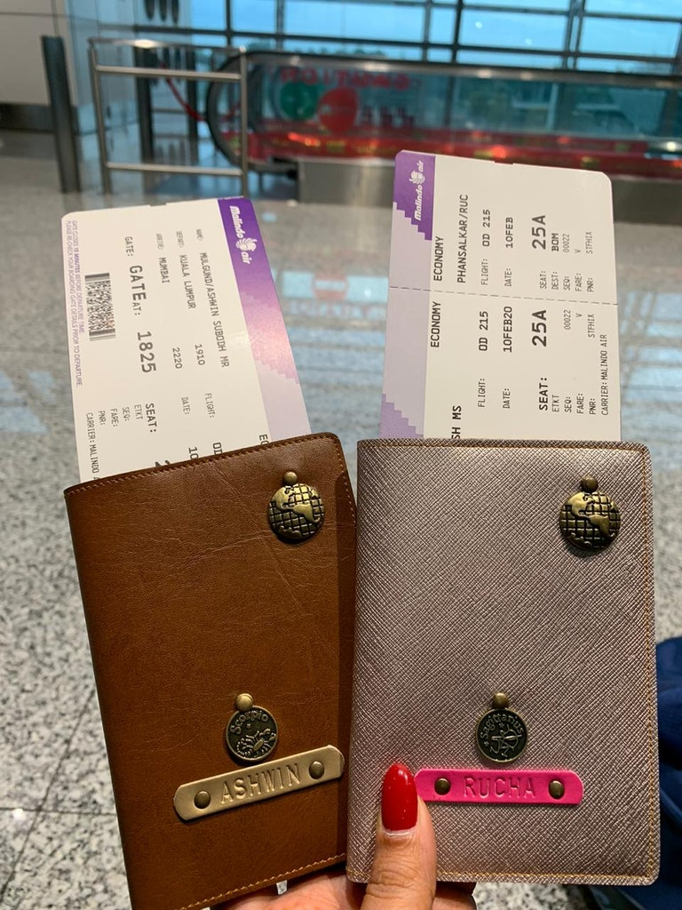 A picture of a couple's passports and flight tickets for their trip