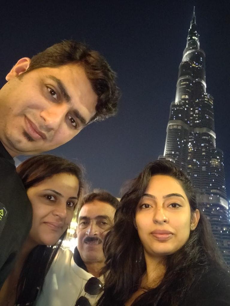 A group of people posing at the Burj Khalifa in Dubai