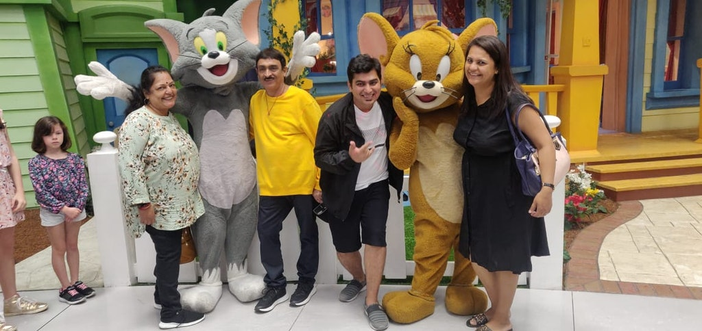 A group of people posing with the Mickey mouse on their trip to Dubai