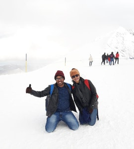 A picture of an amazing couple on the snowy lands of Europe