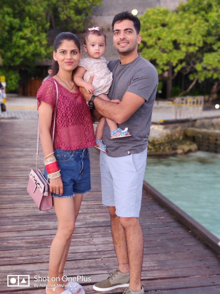 With a cute baby during our Maldives honeymoon