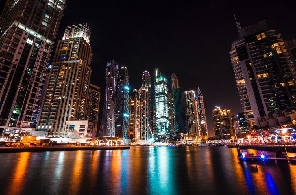 A beautiful picture of Dubai in lights and its reflections on the water