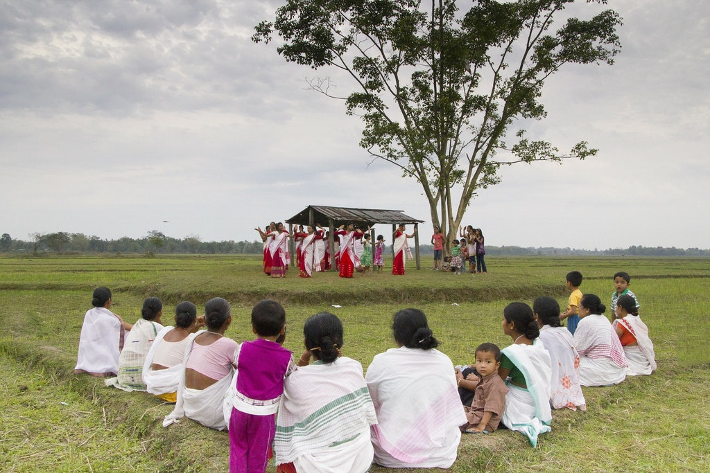 A group of dancers performing in the Bihu festival of assam