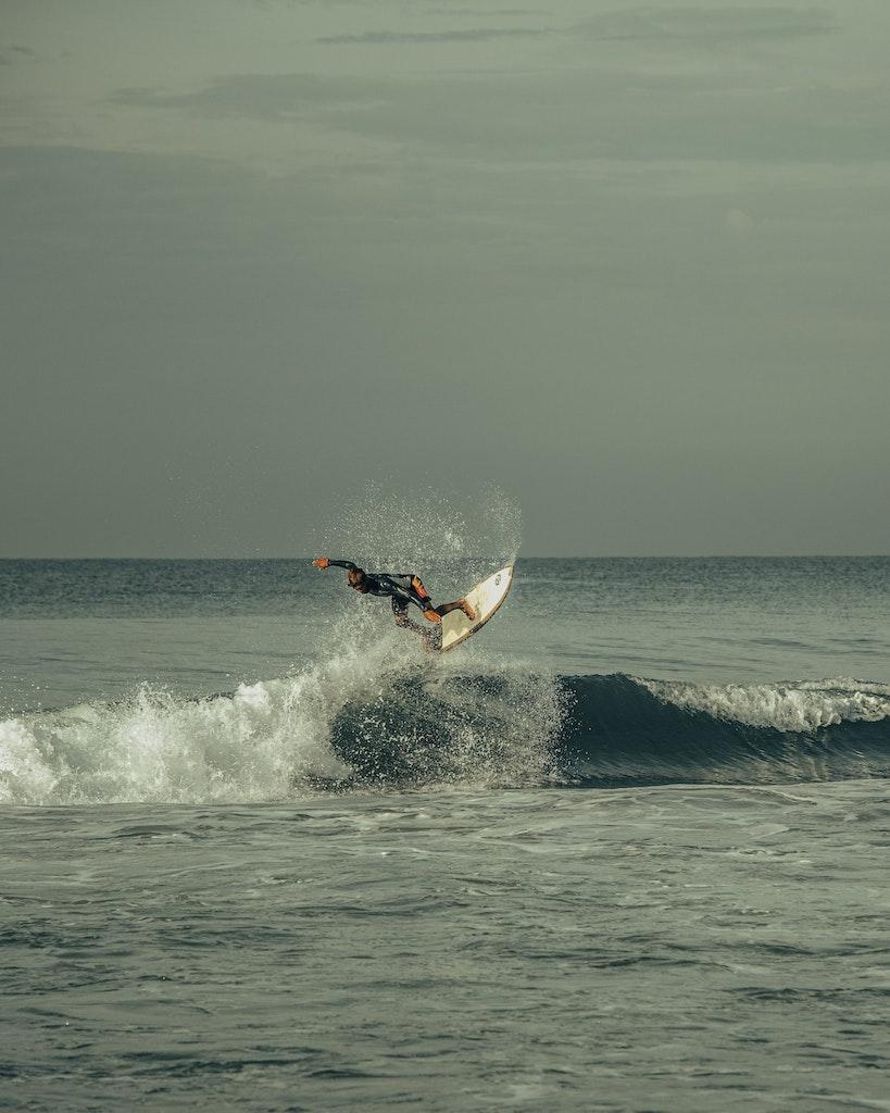 A picture of a man enjoying watersports in Varkala Beach in Kerala