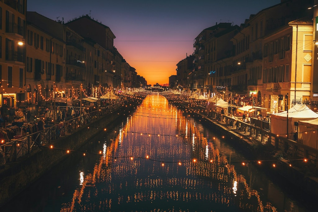 A picture of the city of Milan beautifully decorated with lights