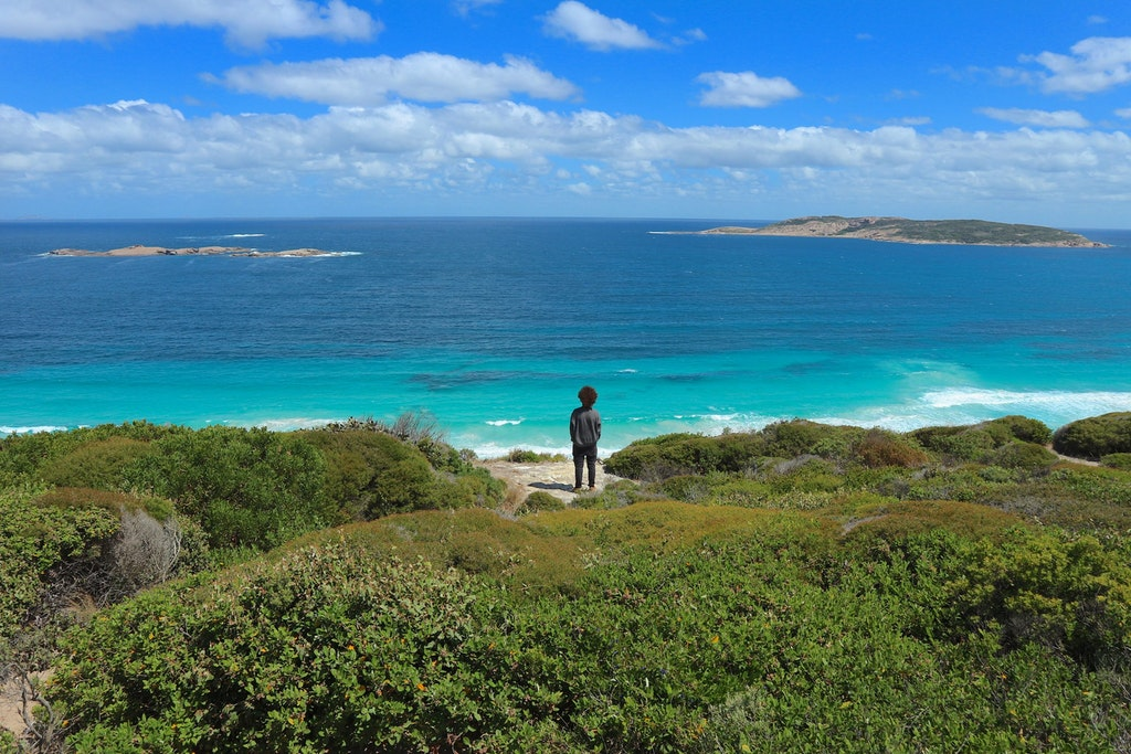 A picture of a guy standing in a beach in Esperance