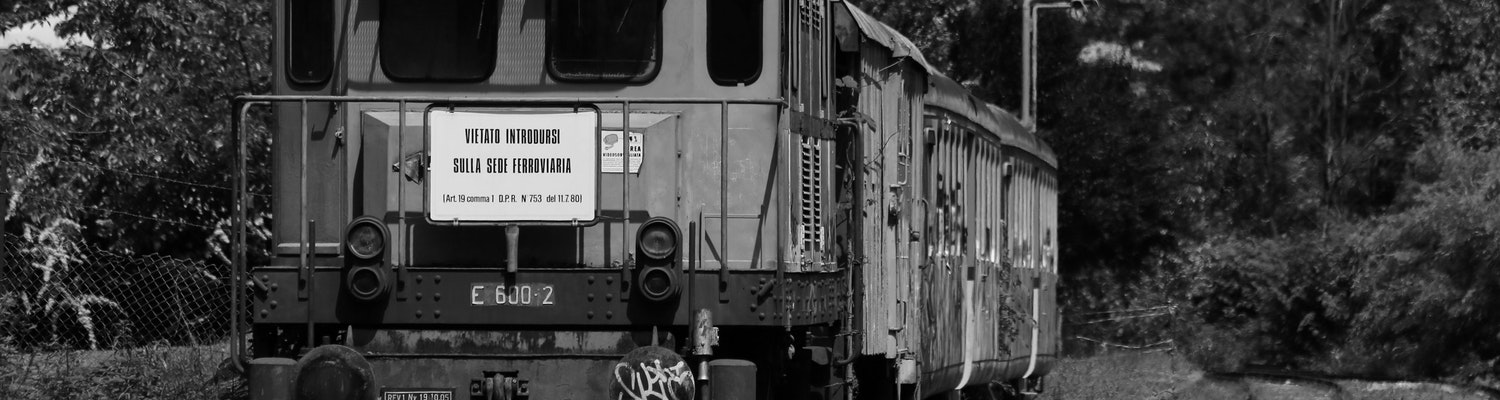 A black and white picture of a train in Varese, Italy