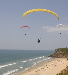 A picture of a group of people paragliding in Varkala