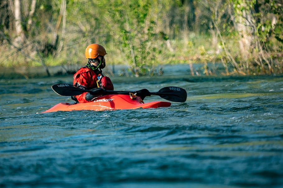 a man kayaking on a river