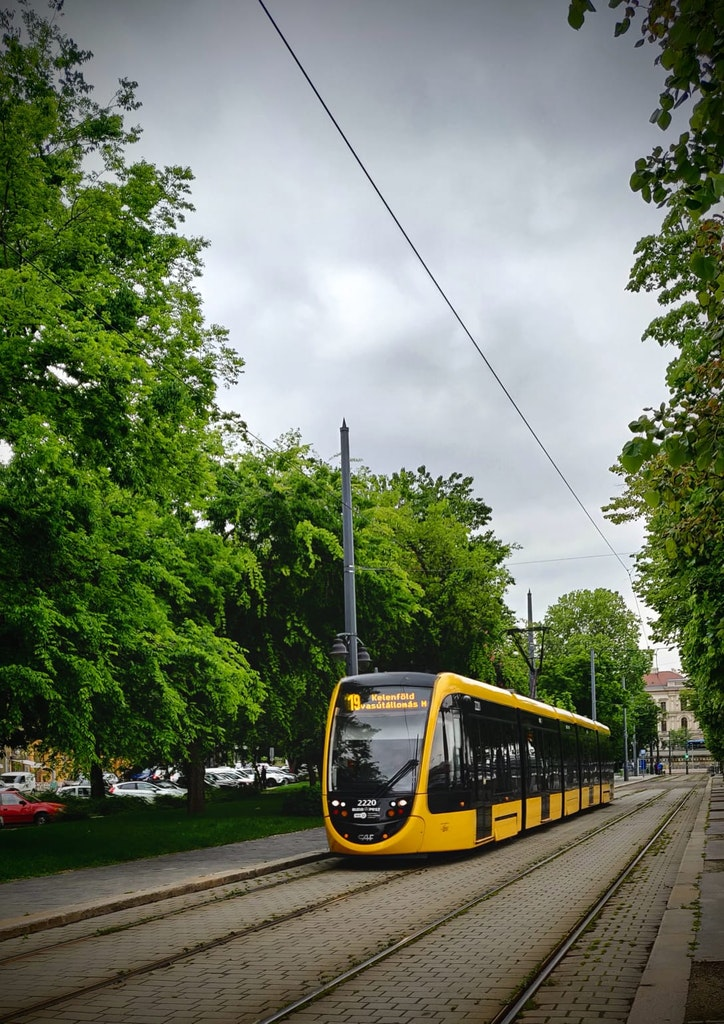 A picture of a bus that was taken at Budapest, on a happy vacation