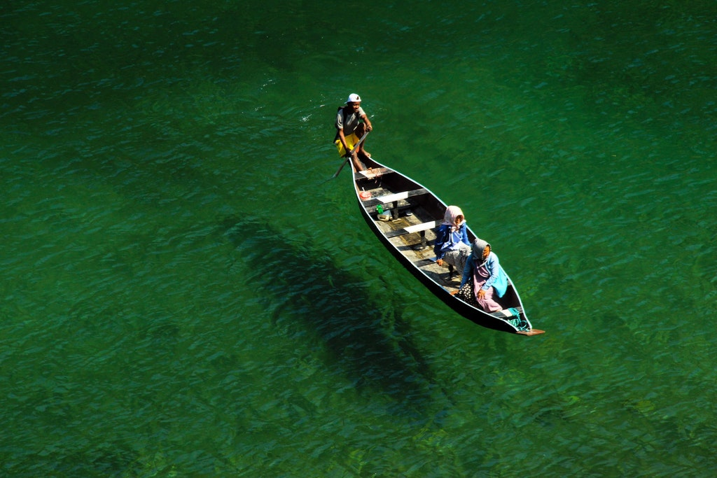 A picture of three people boating in Northeast India
